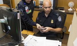 CBP and CBSA cooperate at Canadian international airports by U.S. Customs and Border Protection [Public domain or Public domain], via Wikimedia Commons