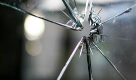 Broken Glass via https://pixabay.com/en/glass-broken-fragmented-hole-crack-1497227/