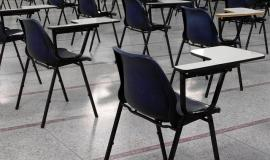 Empty Desks via https://pixabay.com/en/empty-exam-hall-deserted-nobody-314554/