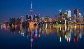 Toronto via https://pixabay.com/photos/buildings-cn-tower-canada-colorful-2297210/