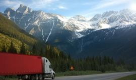 Truck driving in the Rockies via https://pixabay.com/photos/truck-road-shield-warning-canada-2755172/
